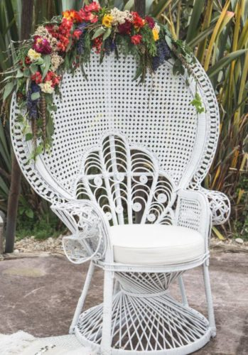 white peacock chair with flowers