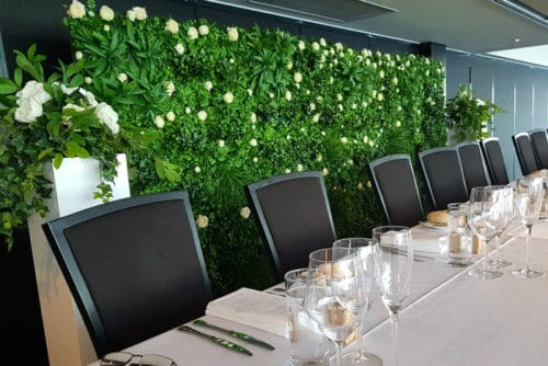 green flower wall at wedding reception