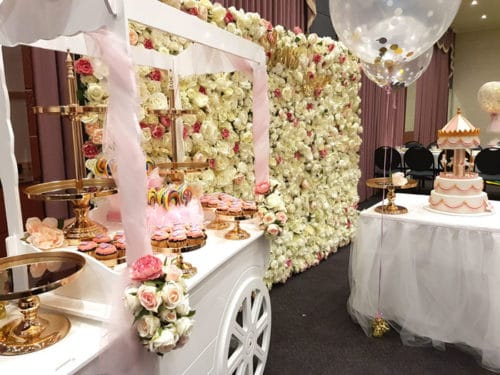 Candy cart and flower wall