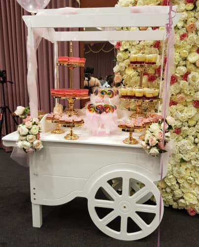 Candy cart with cakes and candy