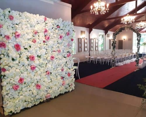 wedding reception flowers and flower wall