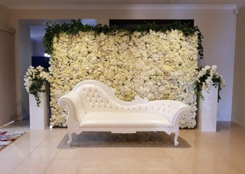 Mehndi (Henna) Ceremony - flower wall and French Chaise